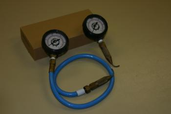 Pressure gauges with attached pitot tubes for measuring pressure inside drip tubing.  Photo: L. Schwankl.
